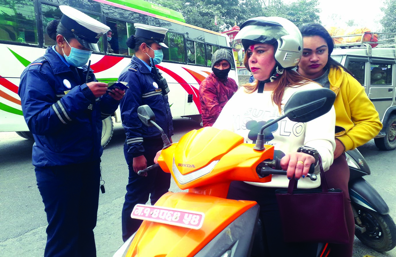 Traffic policewomen checking vehicles in Tanahun, on Wednesday. Photo: THT
