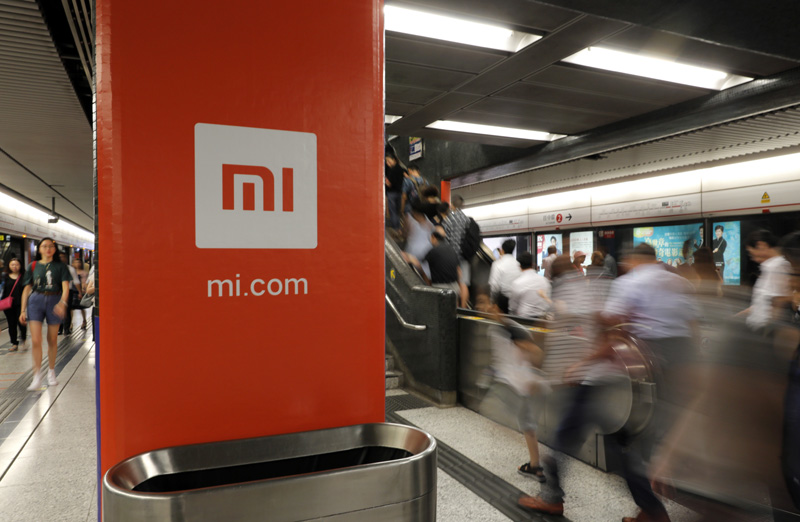 In this July 9, 2018, file photo, an advertisement for Xiaomi is displayed at a subway station in Hong Kong. Photo: AP/File