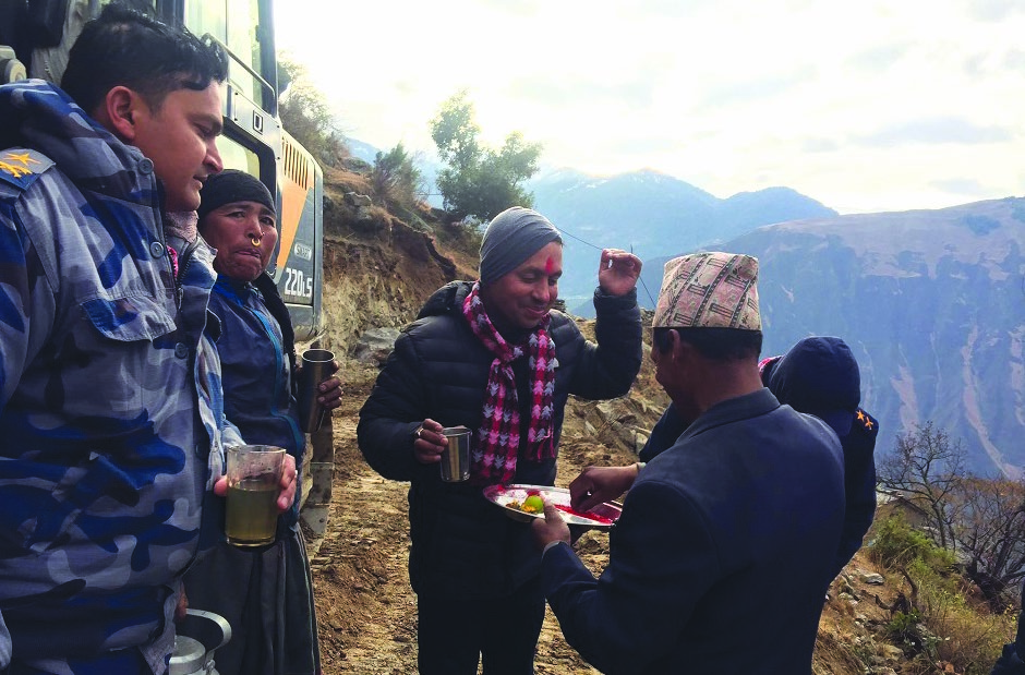 Locals welcoming Chief District Officer Krishna Gaire as he reaches the remote village Muktikot, Bajura, on Thursday. Photo: THT