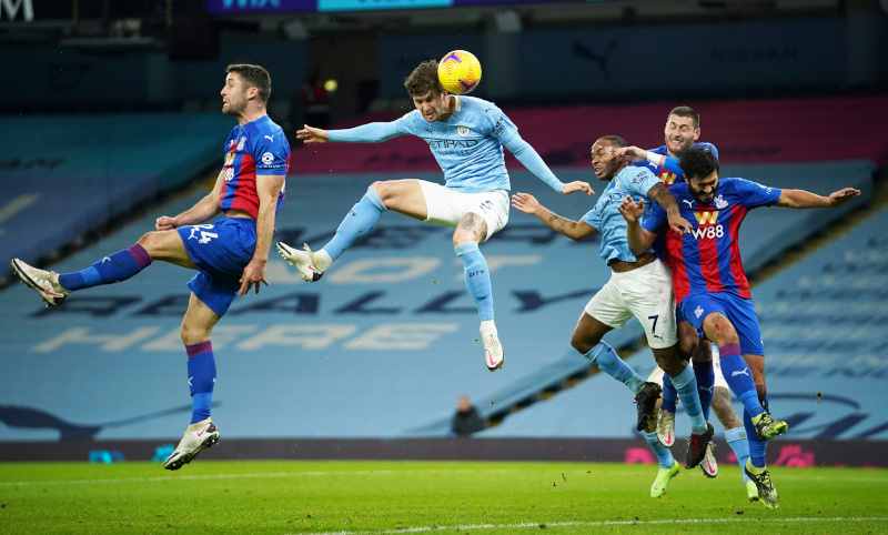 Manchester City's John Stones scores their first goal during the Premier League match between Manchester City and Crystal Palace, at Etihad Stadium, in Manchester, Britain, on January 17, 2021  Pool via Reuters