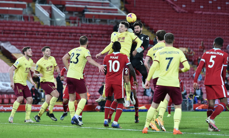 Liverpool's Alisson in action with Burnley's Matthew Lowton during the Premier League match between Liverpool and Burnley, at Anfield, in Liverpool, Britain, on January 21, 2021. Photo: Pool via Reuters