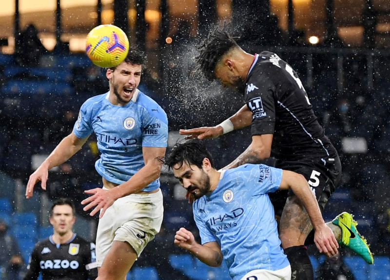 Aston Villa's Tyrone Mings in action with Manchester City's Ruben Dias and Ilkay Gundogan during the Premier League match between Manchester City and Aston Villa, at  Etihad Stadium, in  Manchester, Britain, on January 20, 2021. Photo: Pool via Reuters