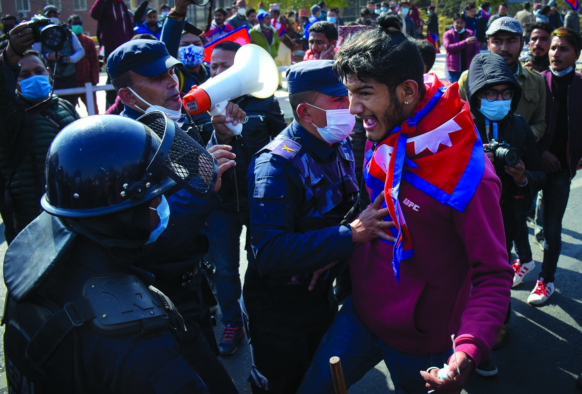 Monarchy supporters clashing with riot police as they march ahead demanding reinstatement of monarchy during the 299th Prithvi Jayanti at Singha Durbar, Kathmandu, on Monday. Photo: THT