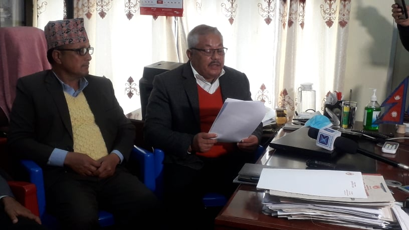 Minister for Physical Infrastructure and Development Jhapat Bhadur Bohara (right) prepares to file his resignation in Dhangadhi, on Wednesday, January 06, 2020. Photo: Tekendra Deuba/THT
